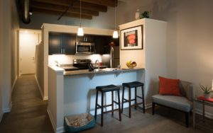 Apartment kitchen with breakfast bar and open floor plan at Shadyside Commons in Pittsburgh, PA