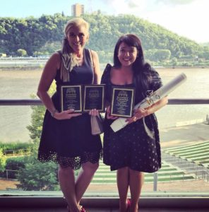 Kathleen Brown and Angela Franco Holding Apartment Association Awards